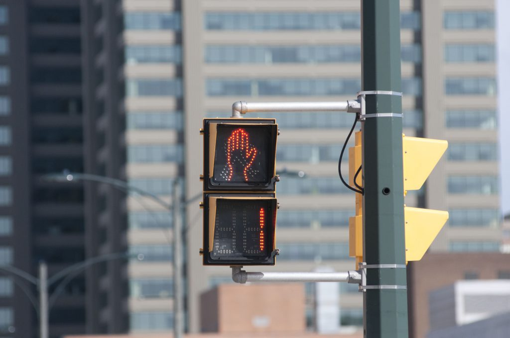 crosswalk counting down to one
