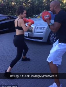 Kim Kardashian, a pointless celebrity, boxes in a parking lot
