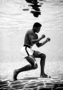 Muhammed Ali boxing under water