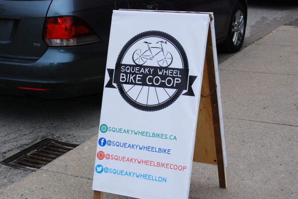 Squeaky Wheel Bike Co-op sign