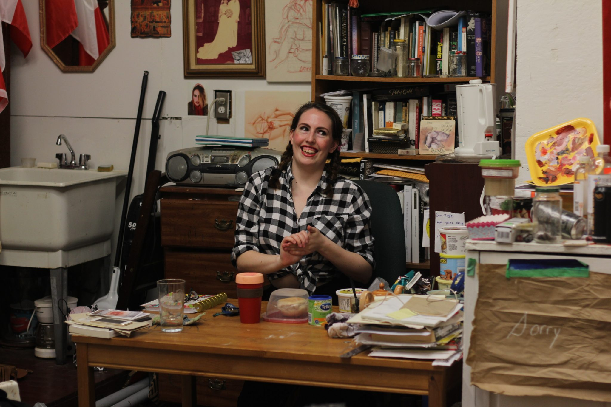 angie quick (artist) sits in her studio