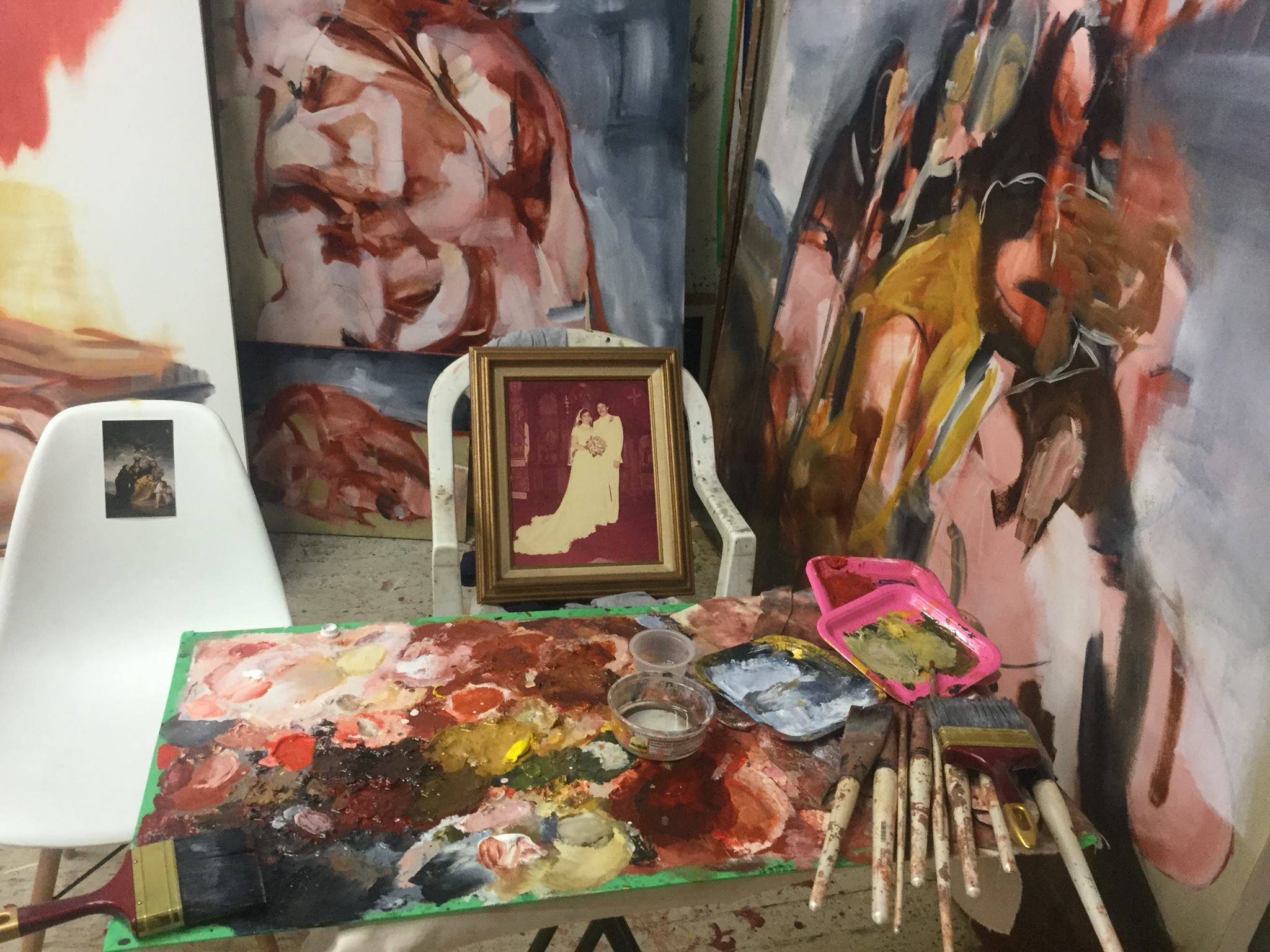 a collection of paintings in Angie's studio