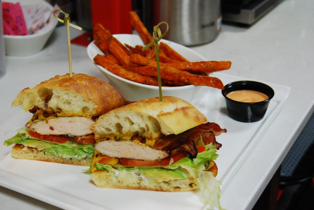 A chicken club sandwich from the Twisted Toque with sweet potato fries and chipolte mayo.