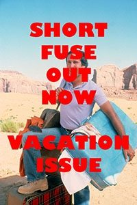 Chevy Chase stands with his foot on a suitcase with the text over him that says short fuse out now vacation issue