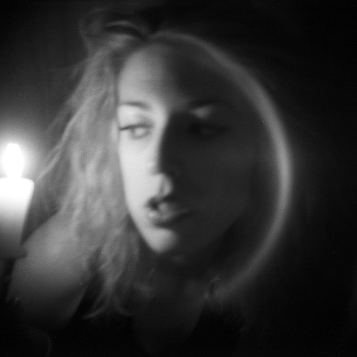 film photo - woman with candle
