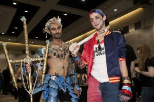Justin Hoag, a gender-bent Harley Quinn, and Stephan Raposo, a merman at Forest City Comicon. Photo by Ed Phin.