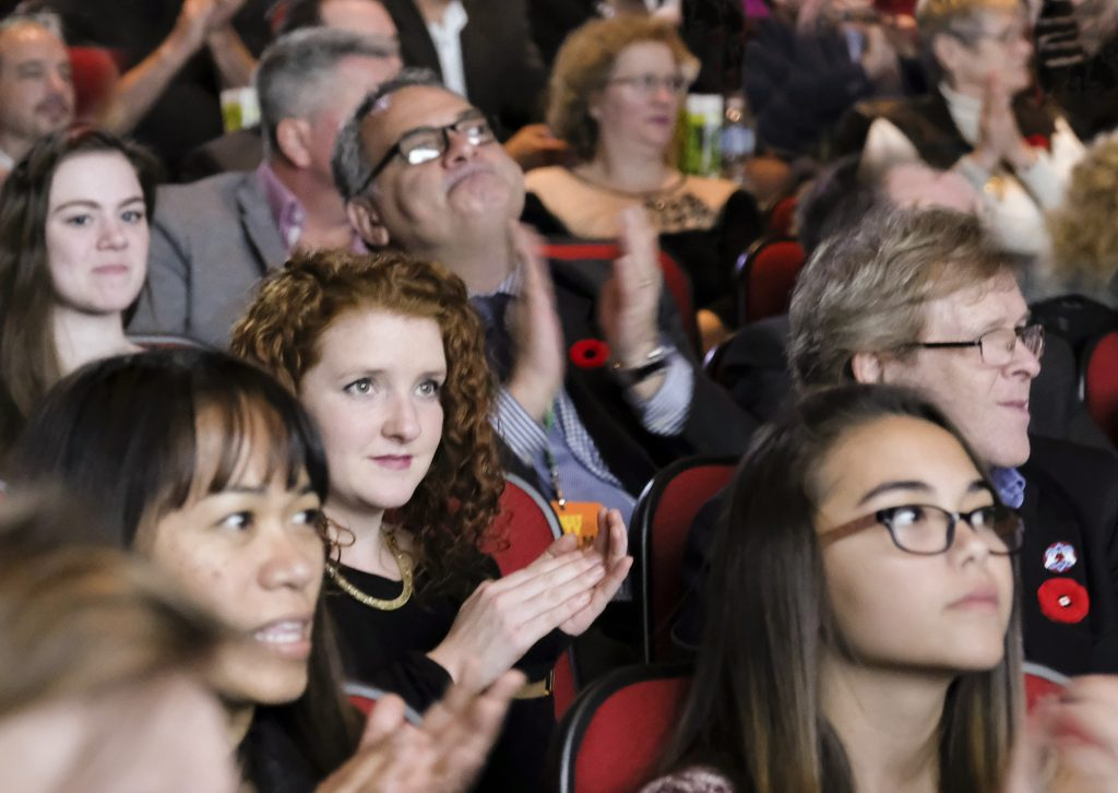 An Audience clapping at the Forest City Film Festival.