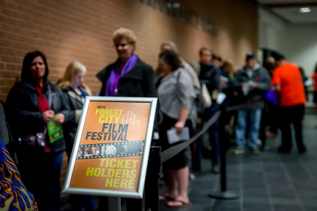 People lining up at the Forest City Film Festival.