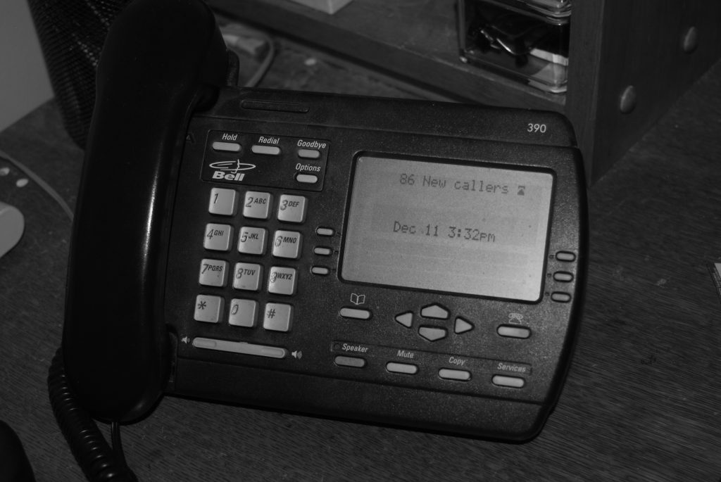 A black and white photo of a phone.