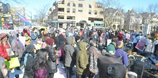 The crowd gathers in Victoria Park for the International Women's Day rally March 3.