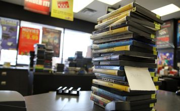 Stacks of videos on the counter at Jumbo Video.