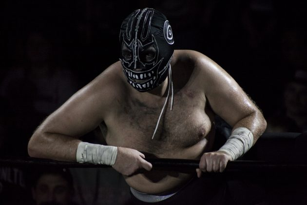 Evil Uno glares on from ringside during his main event match against enemies Tyson Dux and Cody Deaner.