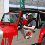 "Michael Bergeron in a 1992 Jeep Wrangler with the ""Jurassic Park"" logo for Free Comic Book Day in London, Ontario. Photo by Emily Stewart."