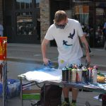 Artist JPaintings spray painting a t-shirt during Free Comic Book Day in London, Ontario. Photo by Emily Stewart.