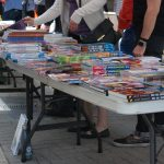 Several Londoners exploring the Heroes Comics sidewalk sale for Free Comic Book Day 2018 in London, Ontario. Photo by Emily Stewart.