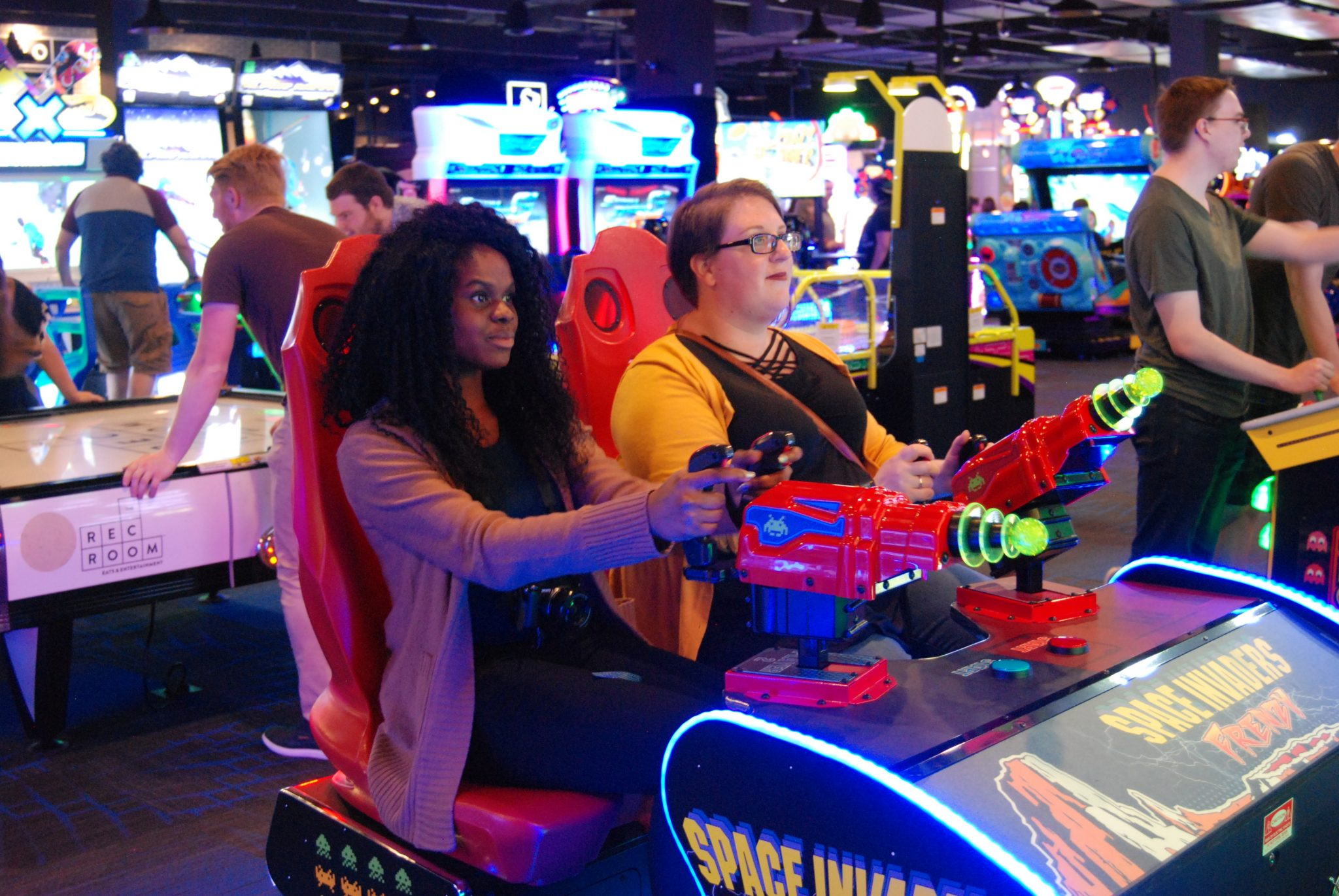 """Satisfy your hunger for gaming at the Rec Room. Dishan Anderson and Laura Thorne playing """"Space Invaders Frenzy"""" at the Rec Room in London, Ontario."""
