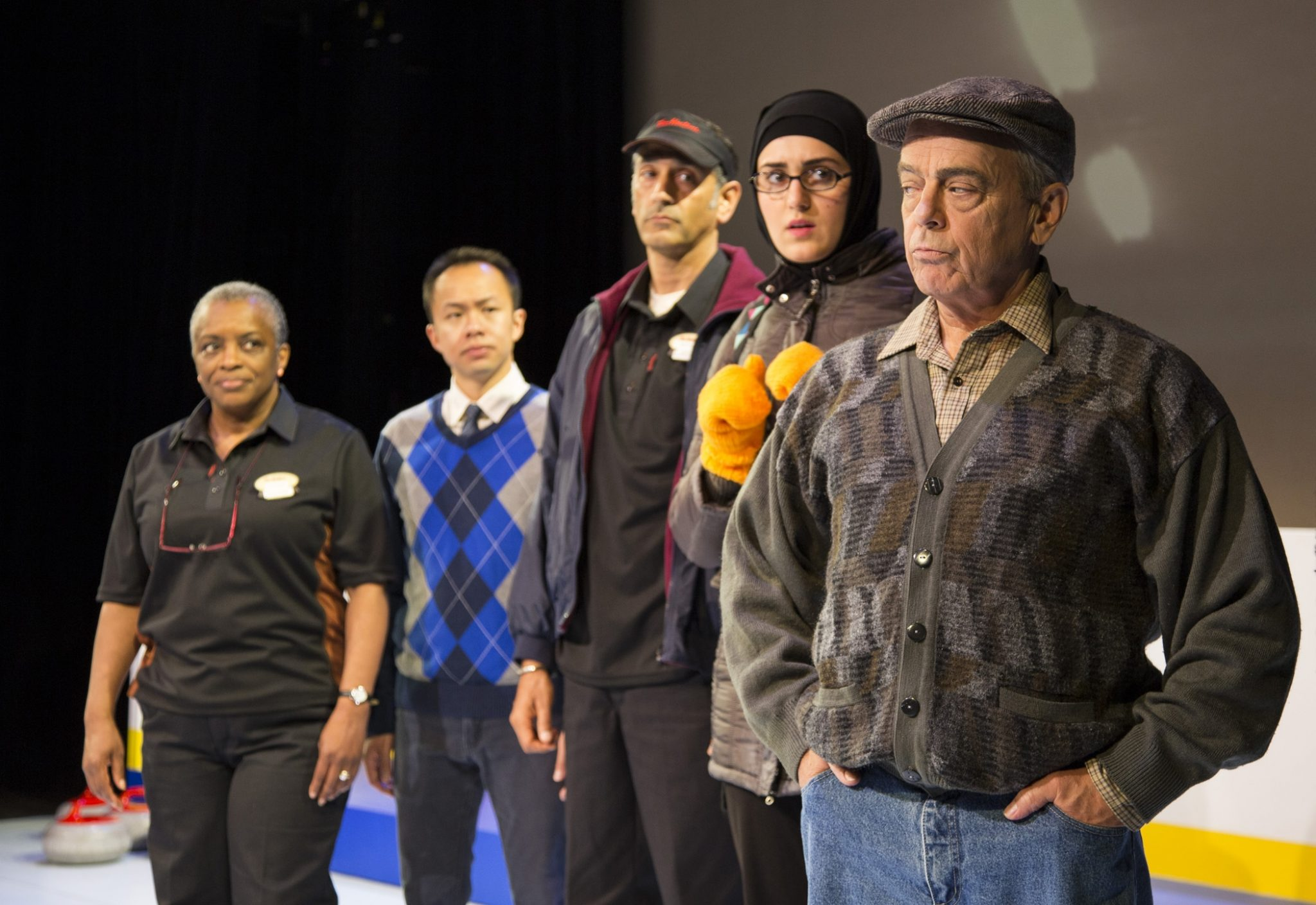 Marcia Johnson as Charmaine Bailey, Matthew Gin as Mike Chang, Omar Alex Khan as Anoopjeet Singh, Parmida Vand as Fatima Al-Sayeed, and Lorne Kennedy as Stuart MacPhail in The New Canadian Curling Club, a play written by Mark Crawford and directed by Miles Potter, which opens the 44th season of the Blyth Festival on June 22. Photo credit: Terry Manzo.
