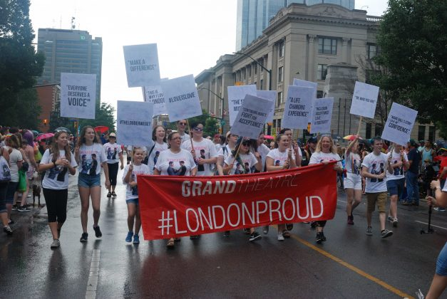 24th Annual London Pride Parade. A group of people marching on behalf of the Grand Theatre in the Pride Parade in London, Ontario. Photo by Emily Stewart.
