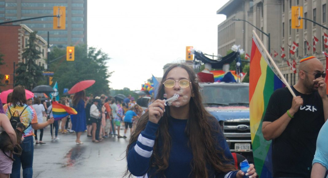 24th Annual London Pride Parade. A girl blowing bubbles at the 24th annual Pride Parade in London, Ontario. Photo by Emily Stewart.