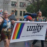 Two people dressed as unicorns holding a sign for the Unity Project at the 24th annual Pride Parade in London, Ontario. Photo by Emily Stewart.