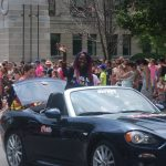 24th Annual London Pride Parade. Saidat waving to people watching the Pride Parade in London, Ontario from her car. Photo by Emily Stewart.