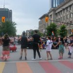 24th Annual London Pride Parade. A circle dance to honour two-spirit people and to advocate for the missing and murdered Indigenous women. Photo by Emily Stewart.