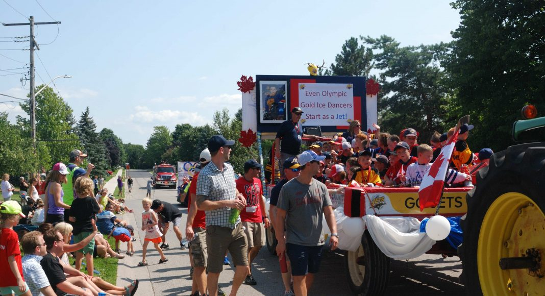 "Thank You Ilderton. The Ilderton Jets Hockey Team float, with a picture of a young Scott Moir, that says ""Even Olympic Ice Dancers start as a Jet,"" during the Thank You Ilderton Parade in Ilderton, Ontario. Photo by Emily Stewart."