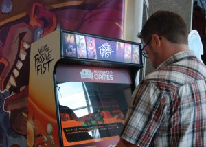 Dave Gertz playing the Wave of the Passive Fist Game at Forest City ComiCon at the London Convention Centre in London, Ontario