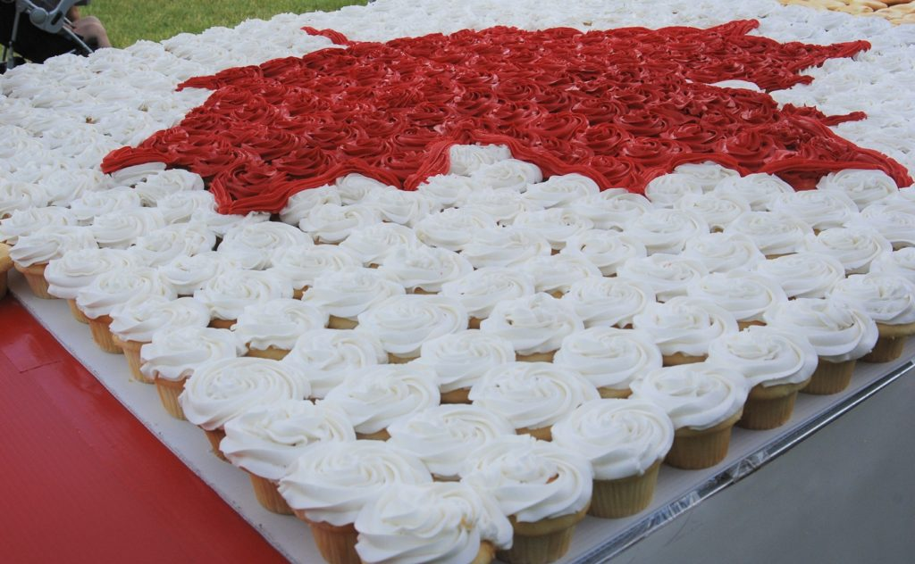 Red and white cupcakes arranged in the shape of a Canada Day flag in Harris Park in London, Ontario.