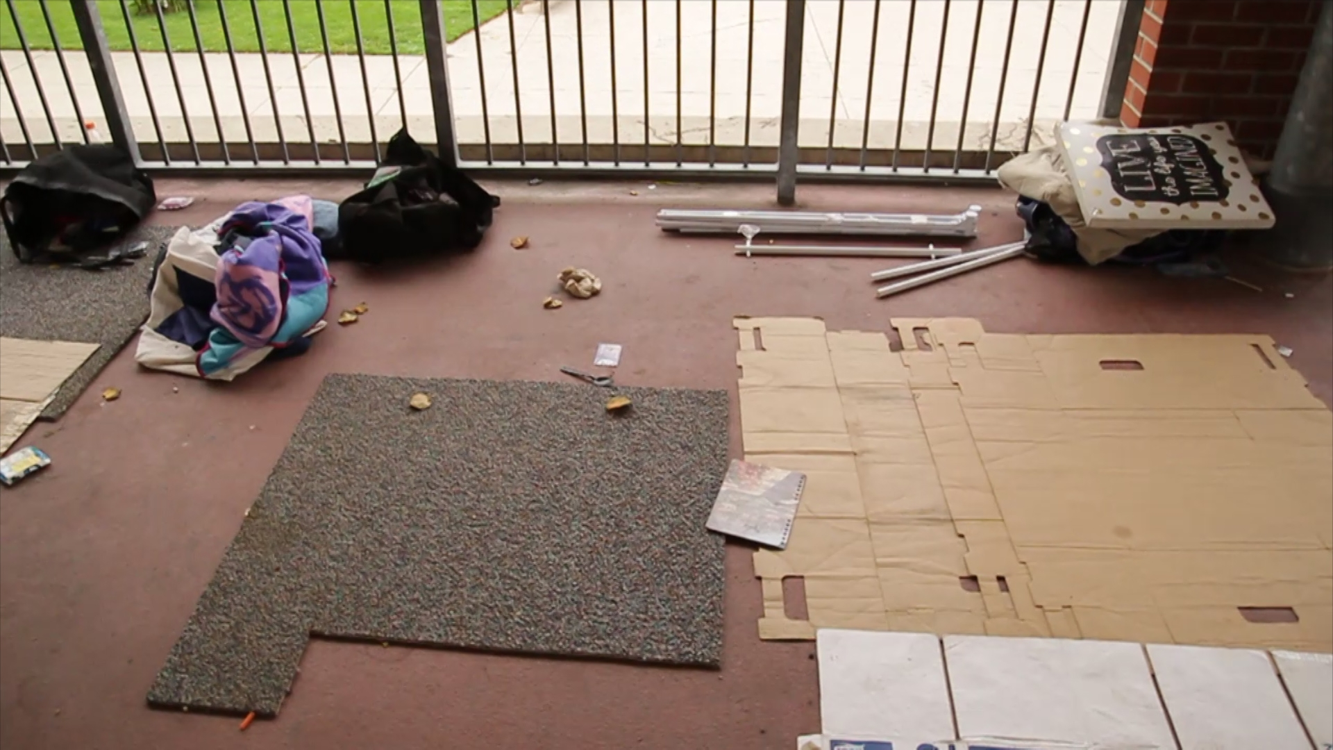 Bits of carpet and cardboard left behind by the occupants of the patio overlooking the park.