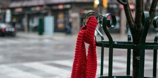Red Scarf began as an installation of red scarves on the street. Regional HIV/AIDS Connection 2015.