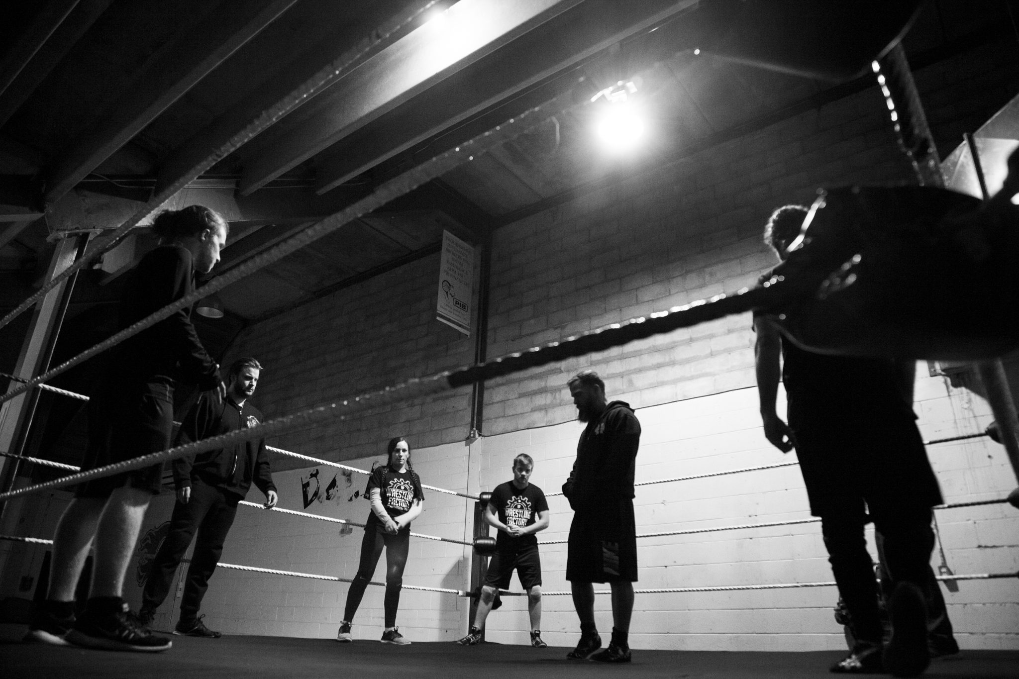 Surrounded by his students, Tyson Dux stands in the middle of the ring during the early months of the Wrestling Factory.