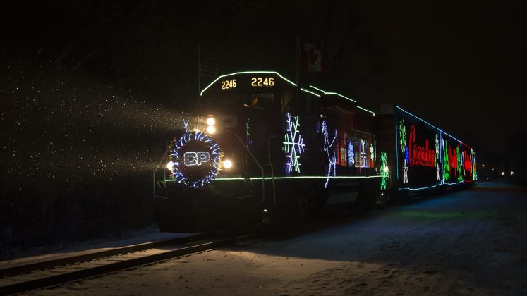The CP Holiday Train makes its way in the cold and dark. Photo by Chad Smith.