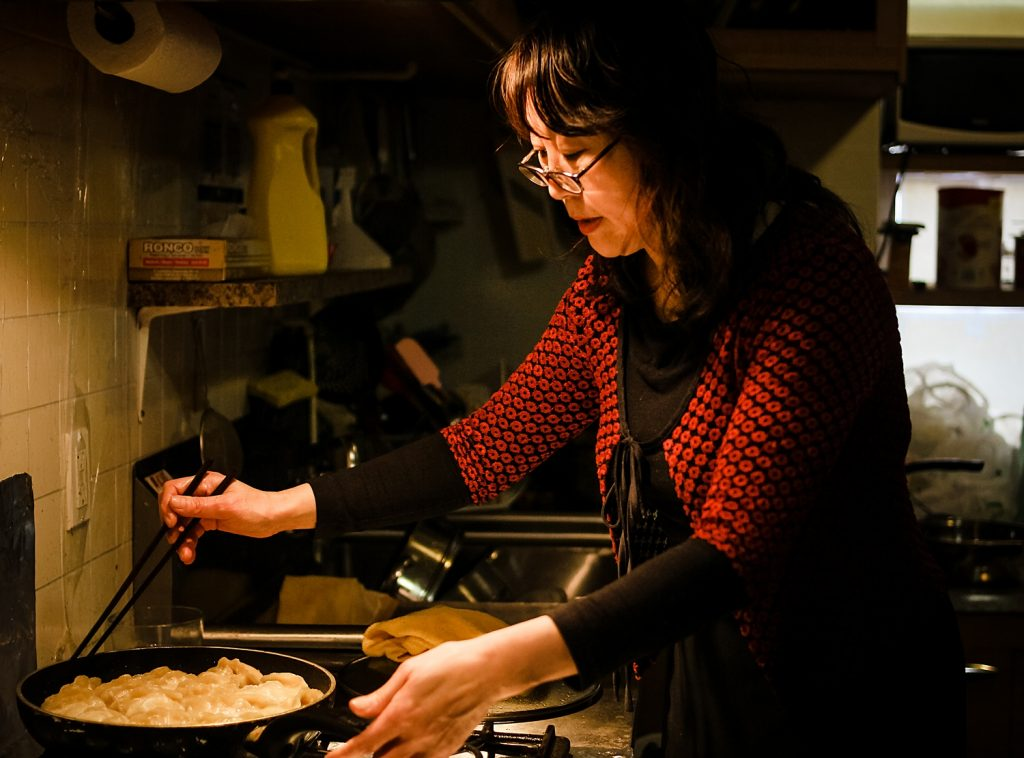 Diane Yamei Min at the kitchen preparing pan-fried dumplings