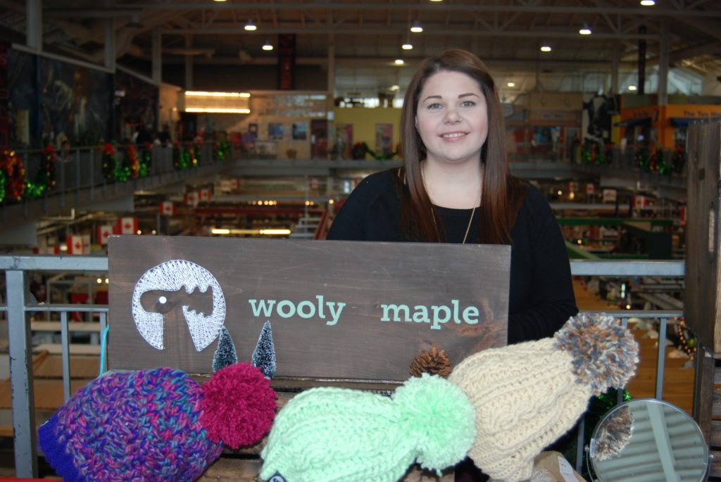 Ashley Burt of Wooly Maple with her display of hats at the Covent Garden Market in London, ON