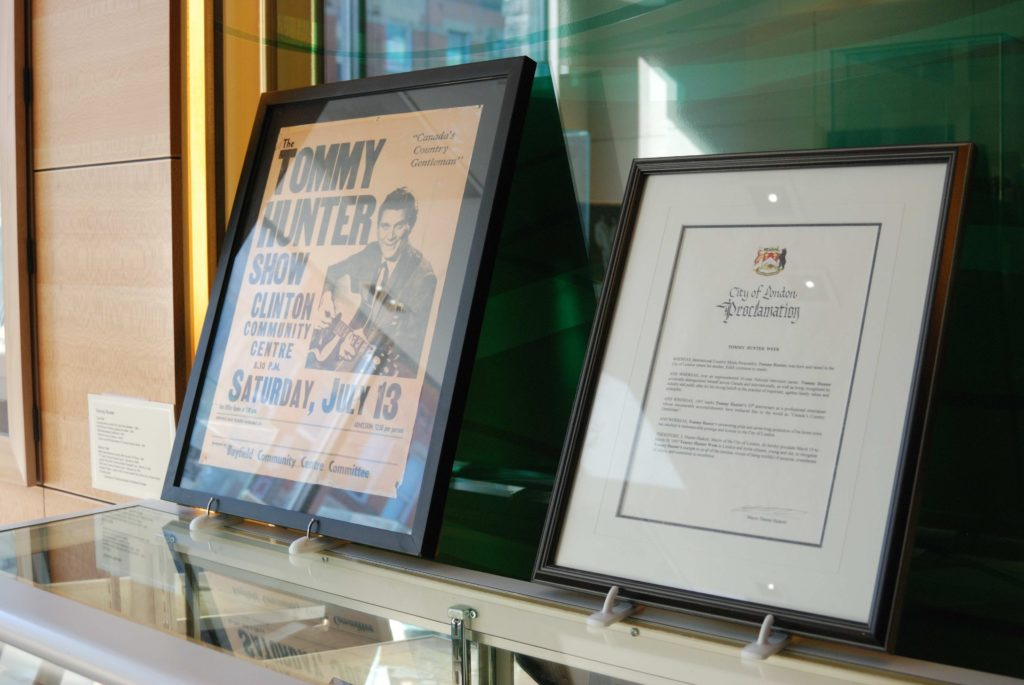 A framed article of Tommy Hunter and a framed declaration of Tommy Hunter Day at the London Music Hall of Fame in London, ON.