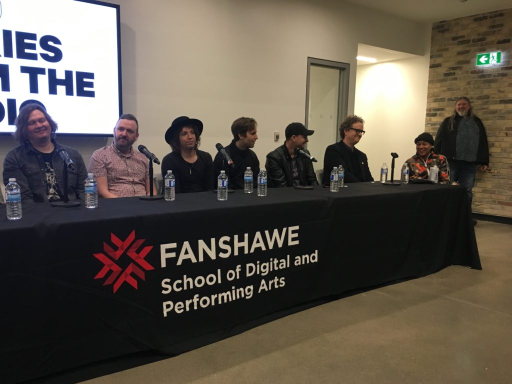 Left to right: Eric Ratz, Thomas D'Arcy, Steve Bays, Robbie Lackritz, Jason Dufour, Greg Wells, and Rookz speaking at the Stories from the Studio panel