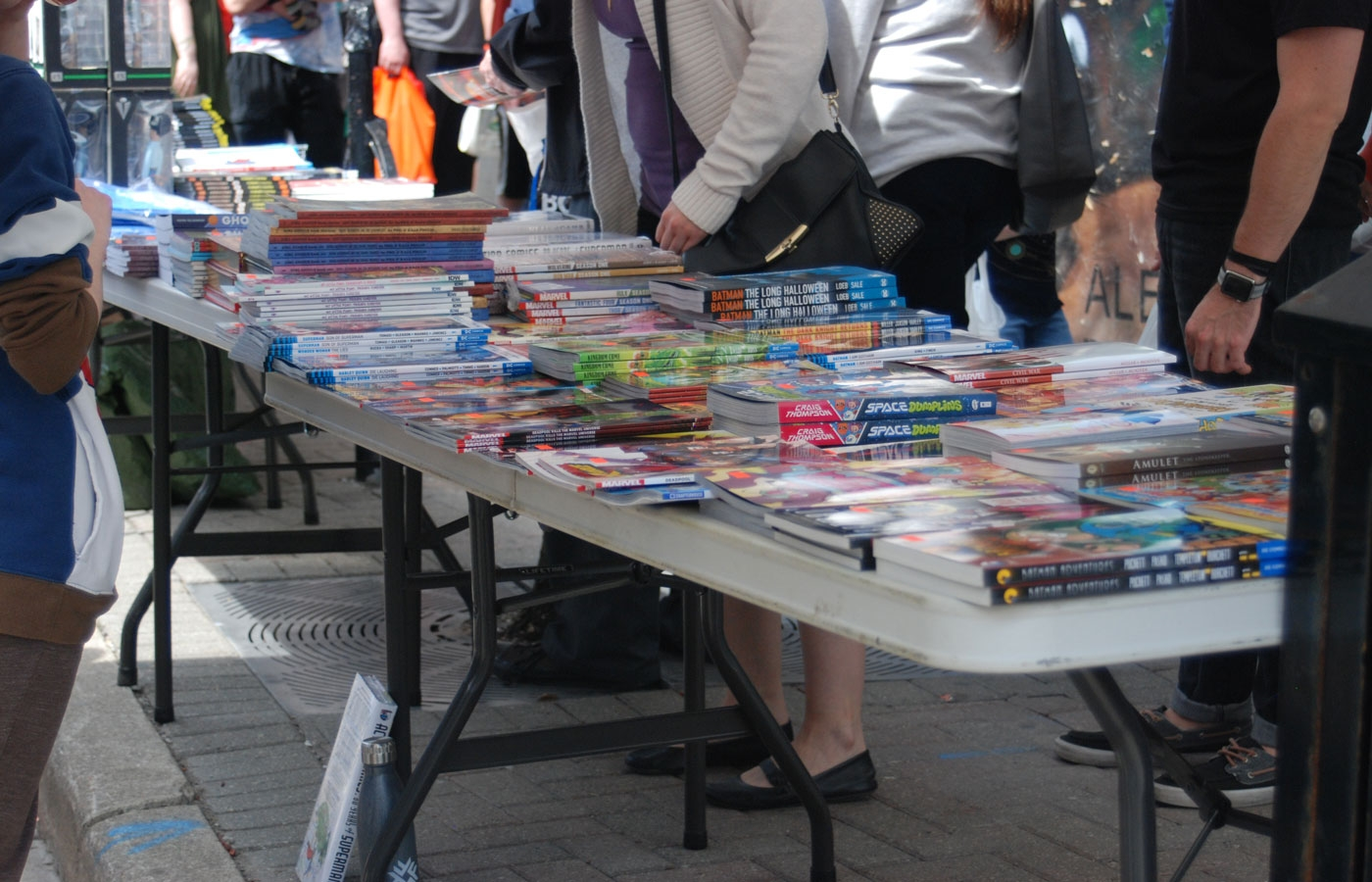 A sidewalk sale outside of Heroes Comics during Free Comic Book Day in London, ON.