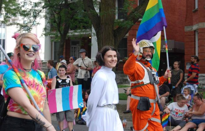 "25th Annual London Pride Parade marchers, including one dressed like Princess Leia and another as a pilot from ""Star Wars"""