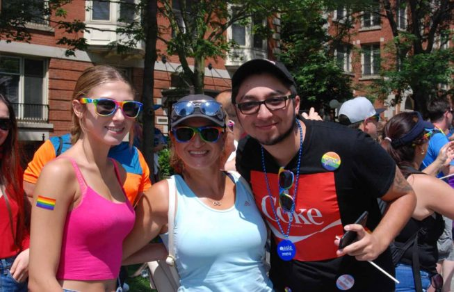 Three people at the 25th Annual London Pride Parade