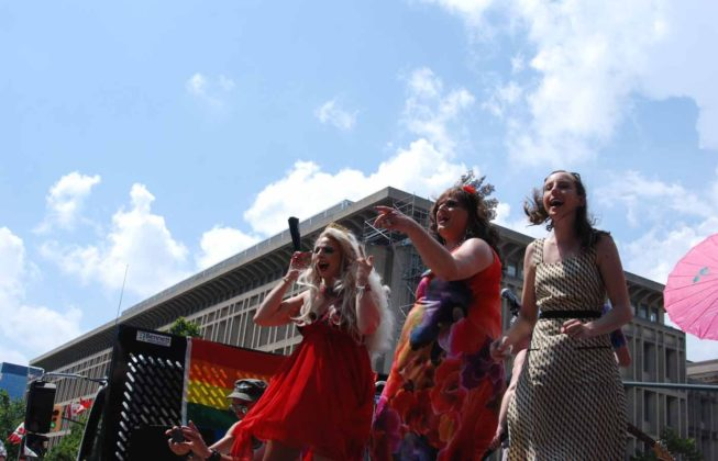 People singing at the 25th Annual London Pride Parade