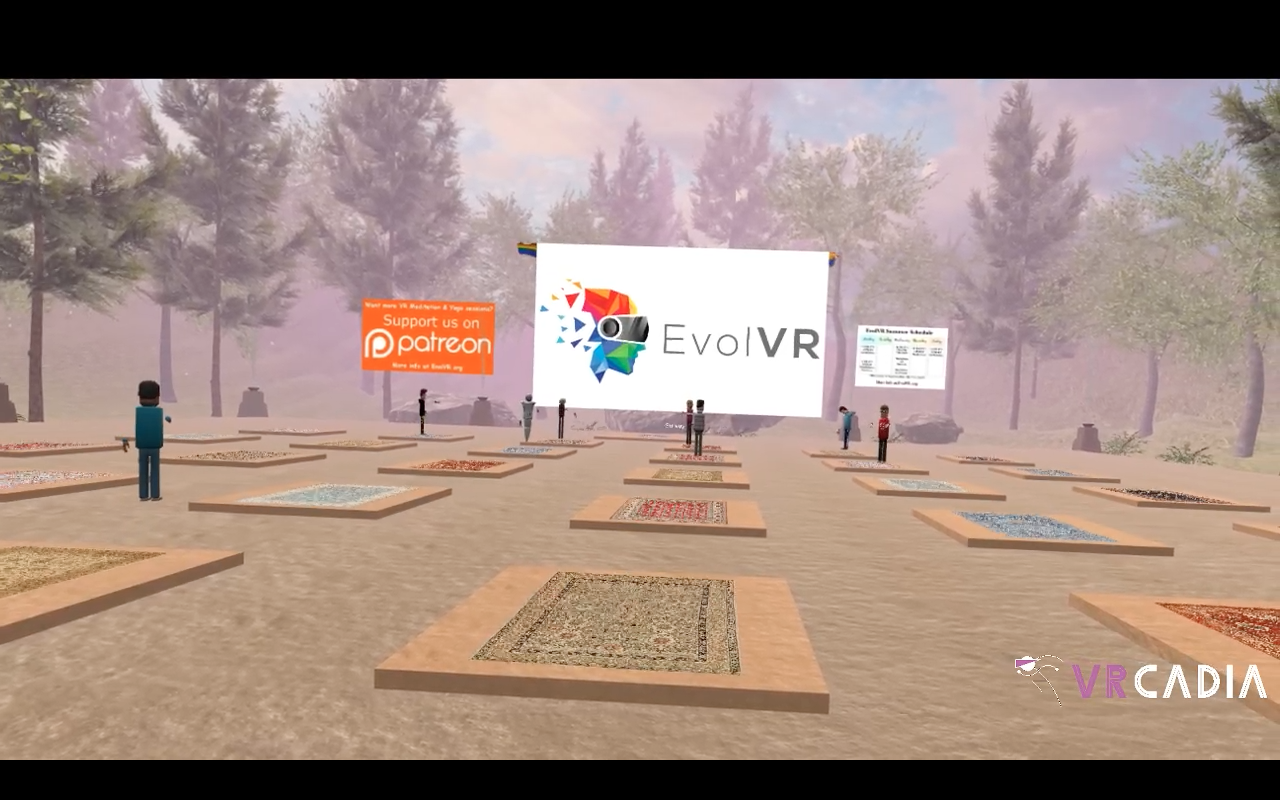 """A VR forest with pillars and rugs on top of the pillars. People are scattered at the front and there's a pink tone to the image. The VRcadia logo, a running stick figure with a VR helmet and the words """"VRcadia"""" in purple and white text are in the bottom left corner."""
