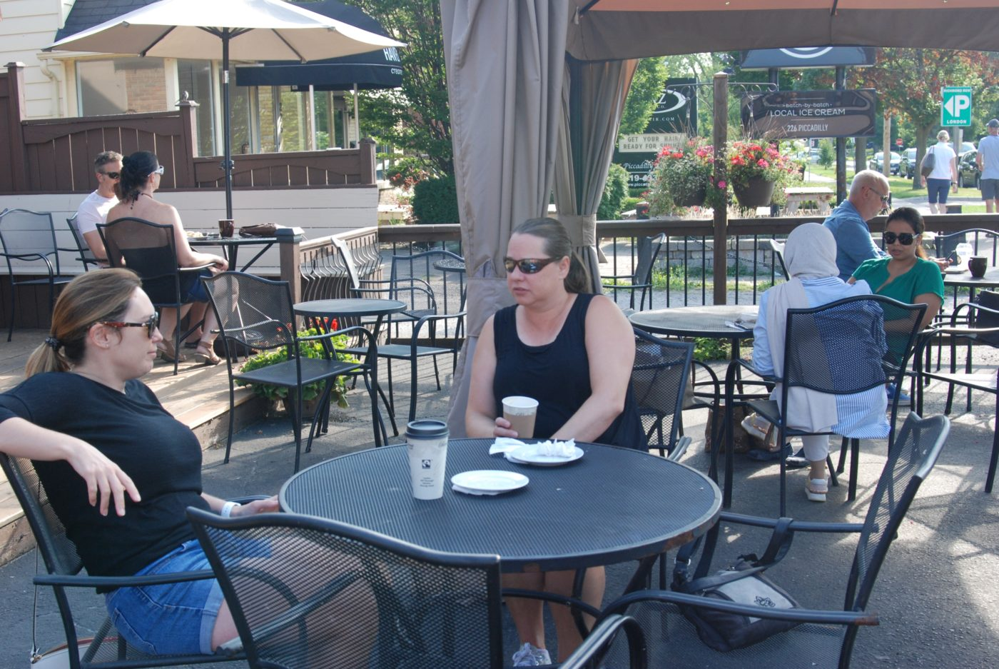 People at the Black Walnut Bakery Cafe patio in London, Ontario.