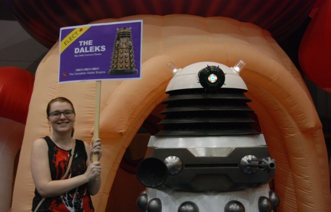 Erin Grant and a Dalek from the Doctor Who Society of Canada encouraging Londoners to vote for The Daleks at London Comic Con in London, Ontario