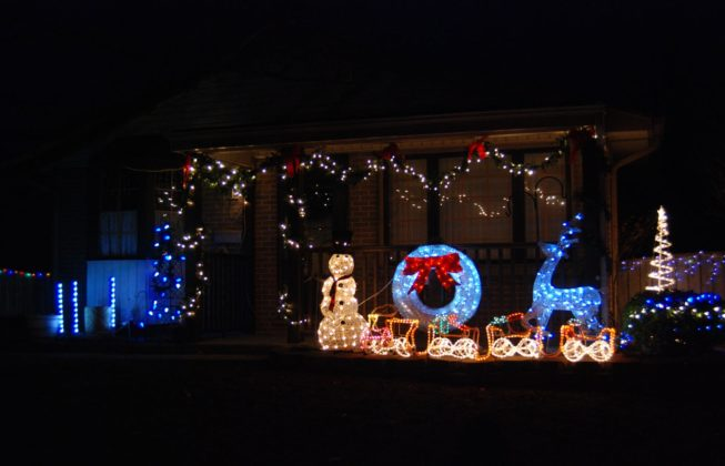 A light display on Jena Crescent in London, Ontario with a lit-up snowman, wreath, and deer