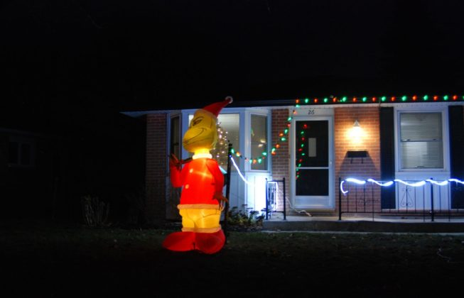 An inflatable grinch stealing lights from a house on Jena Crescent in London, Ontario