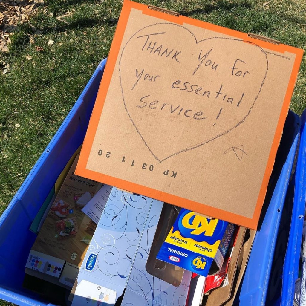A recycling bin with a sign saying thank you for your essential service