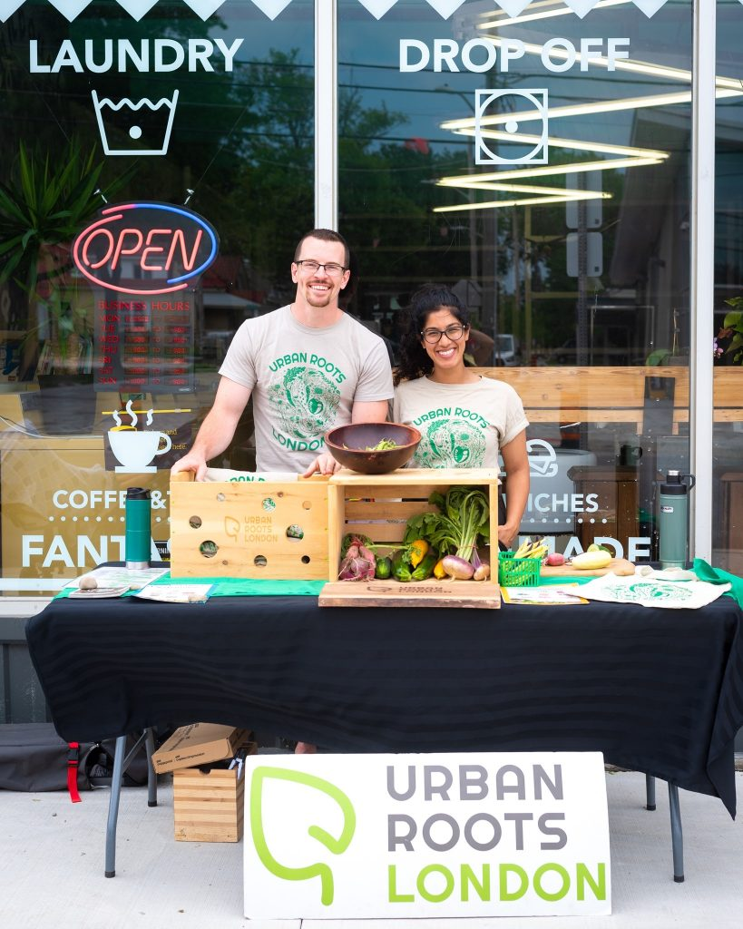 Urban Roots London booth with two people and vegetables