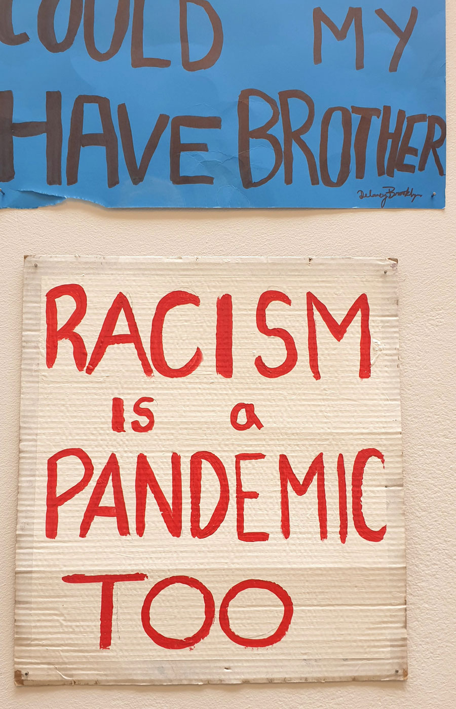 "Two signs from the Black Lives Matter exhibition in London, Ontario. One says ""Could have been my brother"" and another says ""Racism is a pandemic too."""