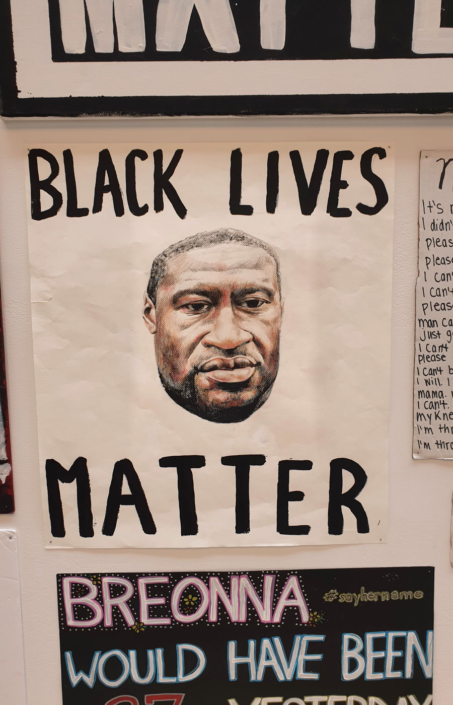 A Black Lives Matter sign with a drawing of George Floyd on it.